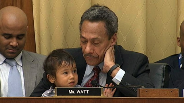 VIDEO: Democratic congressman Mel Watt (N.C.) holds his grandson while questioning U.S. attorney general.