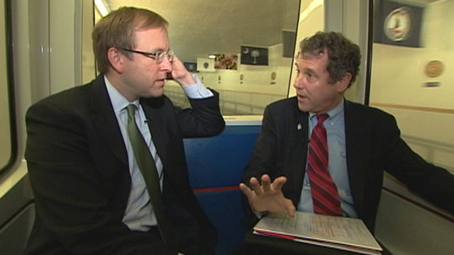 PHOTO Jonathan Karl rides the subway with Senator Sherrod Brown.