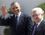 PHOTO:President Barack Obama waves to media as he walks with Palestinian President Mahmoud Abbas, right, as he arrives at the Muqata Presidential Compound Thursday, March 21, 2013, in the West Bank town of Ramallah.