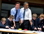 PHOTO: President Barack Obama and British Prime Minister David Cameron help students paint a mural during a visit to the Enniskillen Integrated Primary School in Enniskillen, Northern Ireland, June 17, 2013.