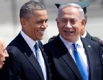 PHOTO: US President Barack Obama, and Israels prime minister Benjamin Netanyahu, right, laugh as they walk during a welcoming ceremony upon Obamas arrival at Ben Gurion airport near Tel Aviv, Israel, March 20, 2013.