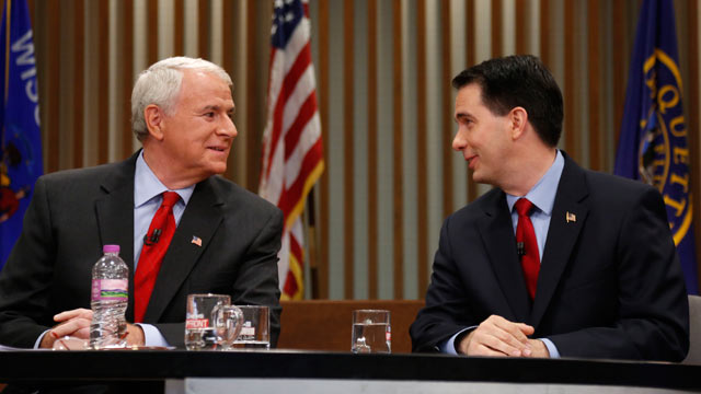 PHOTO: Republican Wisconsin Gov. Scott Walker, right, and Democratic challenger Tom Barrett look at one another as they get ready to participate in a televised debate, May 31, 2012, in Milwaukee.