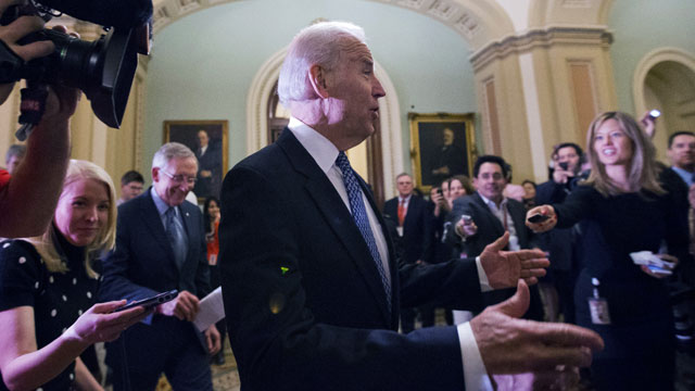 PHOTO:Vice President Joe Biden, center, with Majority Leader Harry Reid, left, of Nevada, arrive for a Senate Democratic caucus meeting about the fiscal cliff, on Capitol Hill Monday, Dec. 31, 2012.