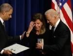 PHOTO: Vice President Joe Biden and Attorney General Eric Holder present the Medal of Valor to Paige Baitinger, Feb. 20, 2013, during a ceremony in the Eisenhower Executive Office Building on the White House complex in Washington.