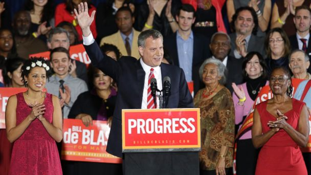 PHOTO: Democratic Mayor-elect Bill de Blasio, flanked by daughter Chiara, left, and wife Chirlane, waves from the stage after he was elected the first Democratic mayor of New York City in 20 years in the Brooklyn borough of New York on Nov. 5, 2013.
