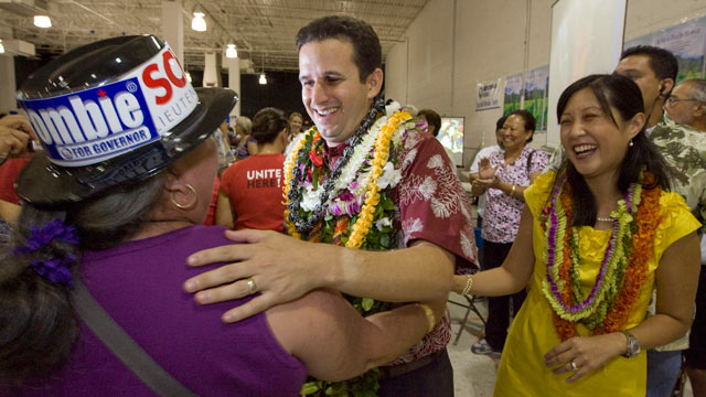 PHOTO: A supporter congratulates then-Lt. governor-elect Brian Schatz, center, as his wife Linda looks on at the Neil Abercrombie-Brian Schatz Hawaii governors post election party in Honolulu, Nov. 3, 2010. Schatz was appointed by Gov. Neil Abercrombie,