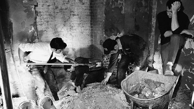 PHOTO: Law enforcement men sift through debris in a rest room on the Senate side of the Capitol, Washington on March 1, 1971 after a bomb exploded in the area.