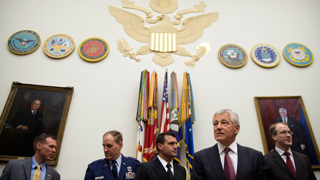 PHOTO: Defense Secretary Chuck Hagel, second from right, stands with staff as he arrives on Capitol Hill in Washington, April 11, 2013, to testify before the House Armed Services Committee hearing on the Defense Departments fiscal 2014 National Defense A