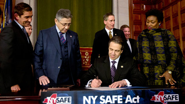 PHOTO: New York Gov. Andrew Cuomo signs New Yorks Secure Ammunition and Firearms Enforcement Act into law during a ceremony in the Red Room at the Capitol, Jan. 15, 2013, in Albany, N.Y.