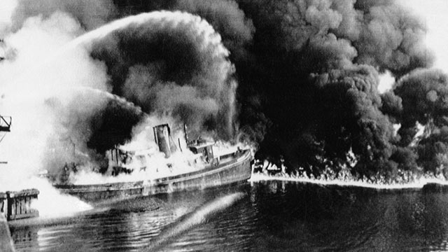 PHOTO: A fire tug fights flames on the Cuyahoga River near downtown Cleveland, Ohio, where oil and other industrial wastes caught fire June 25, 1952.