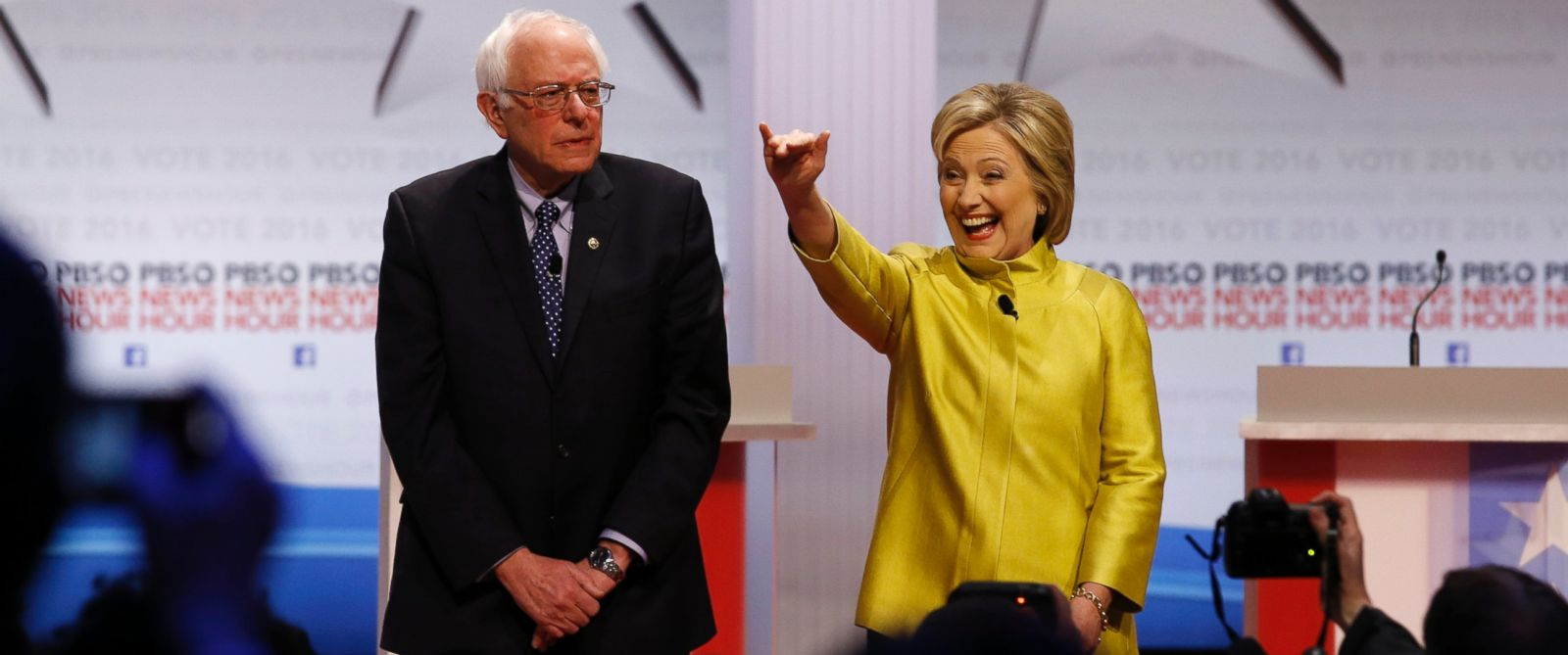 PHOTO: Democratic presidential candidates Sen. Bernie Sanders and Hillary Clinton take the stage before a Democratic presidential primary debate at the University of Wisconsin-Milwaukee on Feb. 11, 2016, in Milwaukee.