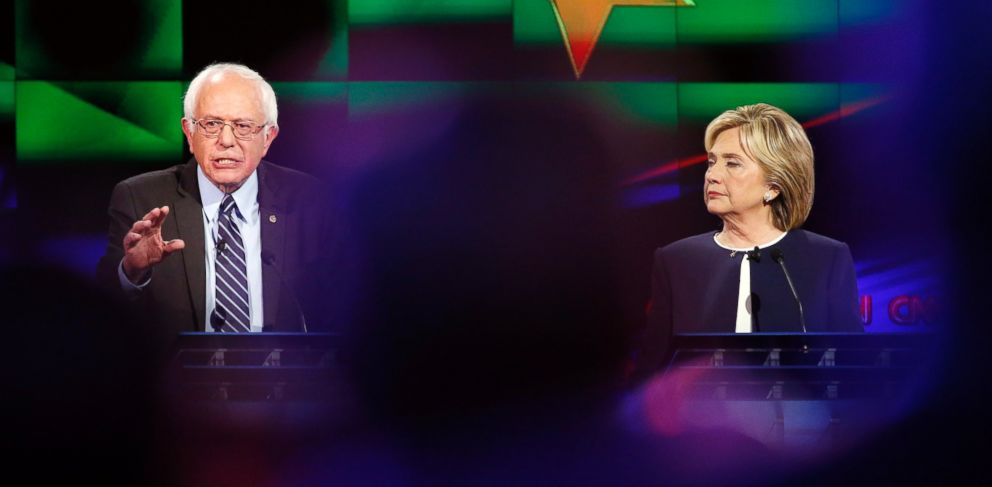 PHOTO: Hillary Rodham Clinton, right, looks on as Sen. Bernie Sanders, of Vermont, speaks during the CNN Democratic presidential debate, Oct. 13, 2015, in Las Vegas.