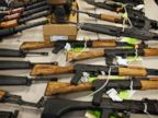PHOTO: A cache of seized weapons is displayed at an ATF news conference in Phoenix, Ariz. on Jan. 25, 2011.