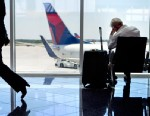 PHOTO: A passenger sits at right in the international terminal at Hartsfield-Jackson airport, April 26, 2013, in Atlanta.