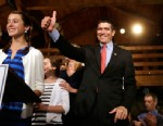 PHOTO: Republican candidate for the U.S. Senate Gabriel Gomez, center, gives a thumbs up as he takes to the stage next to his daughter Olivia, 13, left, before addressing an audience with a victory speech at a watch party, in Cohasset, Mass. on April 30,