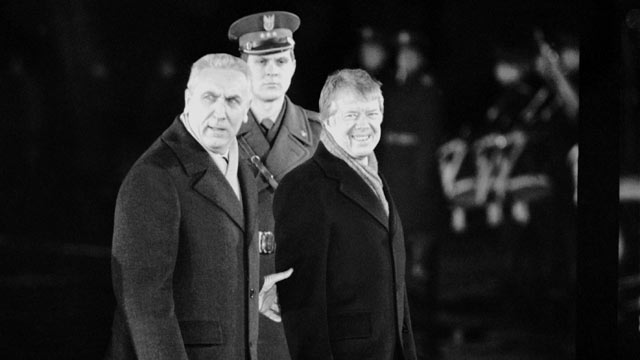 PHOTO: Polish First Secretary Edward Gierek, left, leads the way for President Jimmy Carter during arrival ceremonies in Warsaw, Dec. 29, 1977.