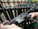 PHOTO: Veetek Witkowski holds a newly assembled AR-15 rifle at the Stag Arms company in New Britain, Conn, April 10, 2013.
