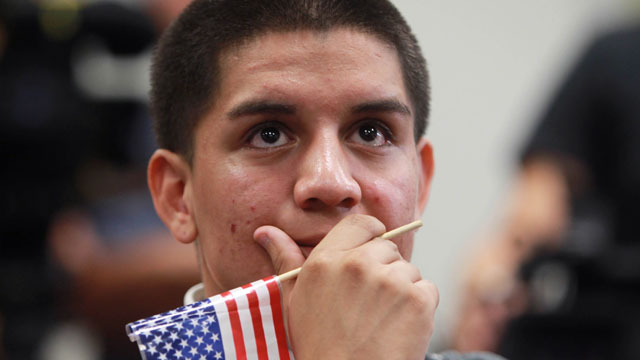 PHOTO:Jose Machado, a student of Nicaraguan descent, reacts during an announcement on the new U.S. immigration law during a news conference at the downtown Wolfson Campus of Miami-Dade College on Friday, June 15, 2012, in Miami.