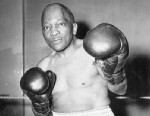 PHOTO: Jack Johnson, age 67, former heavyweight boxing champion of the world, prepares for a boxing exhibiton at a war bond show in New York City, May 1945.