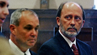PHOTO: Massachusetts state Sen. James Marzilli, right, listens to prosecutor Richard Mucci, during Marzilli's arraignment.