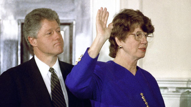 PHOTO: While President Bill Clinton looks on, Janet Reno takes the oath as attorney general during a ceremony at the White House in Washington on March 12, 1993.