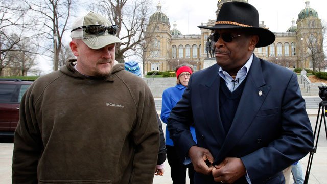 """PHOTO: Former Godfather's Pizza CEO Herman Cain talks with Samuel """"Joe the Plumber"""" Wurzelbacher, left, before speaking at a tea party rally in this April 16, 2011 file photo at the Statehouse in Des Moines, Iowa."""