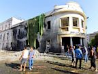 PHOTO: People gather to look at the site of a car bombing in Benghazi, Libya, on Sept. 11, 2013 where a powerful car bomb exploded near Libya?s Foreign Ministry building.