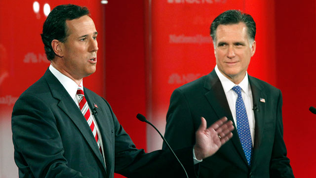 PHOTO: Former Penn. Sen. Rick Santorum gestures as former Mass. Gov. Mitt Romney, right, listens during a Republican presidential debate, Jan. 23, 2012, at the University of South Florida in Tampa, Fla.