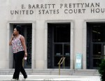 PHOTO: A woman is shown outside the U.S. Courthouse in Washington, where the secret Foreign Intelligence Surveillance Court resides, June 6, 2013.