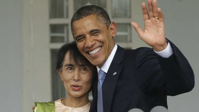 PHOTO: U.S. President Barack Obama, right, waves as he embraces Myanmar democracy activist Aung San Suu Kyi after addressing members of the media at Suu Kyis residence in Yangon, Myanmar, Monday, Nov. 19, 2012.