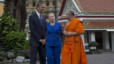 PHOTO: U.S. President Barack Obama, left, and U.S. Secretary of State Hillary Rodham Clinton, center, tour the Wat Pho Royal Monastery with Chaokun Suthee Thammanuwat, Dean, Faculty of Buddhism Assistant to the Abbot of Wat Phra Chetuphon, in Bangkok, Tha