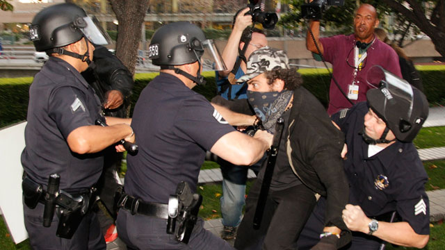 PHOTO: Los Angeles police officers struggle to arrest an unidentified police provocateur in Los Angeles on Nov. 17, 2011.