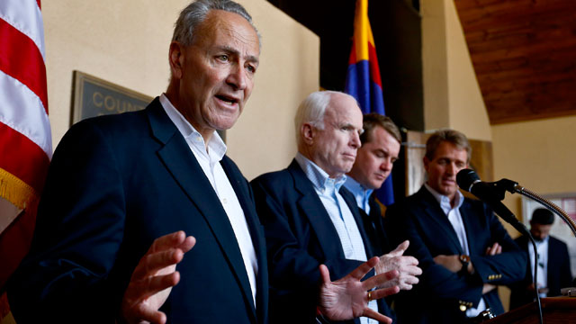 PHOTO: Sen. Chuck Schumer, D-N.Y., left, speaks to the media as, from second left, Sen. John McCain, R-Ariz., Sen. Michael Bennett, D-Colo., and Sen. Jeff Flake, R-Ariz., listen in during a news conference after their tour of the Mexico border with the Un