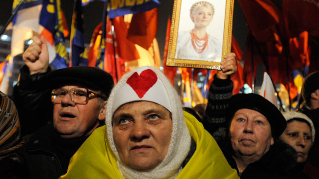 PHOTO: A protester holds up a photo of the imprisoned former Ukrainian Prime Minister, Yulia Tymoshenko, in Kiev, Ukraine, Nov. 12, 2012.