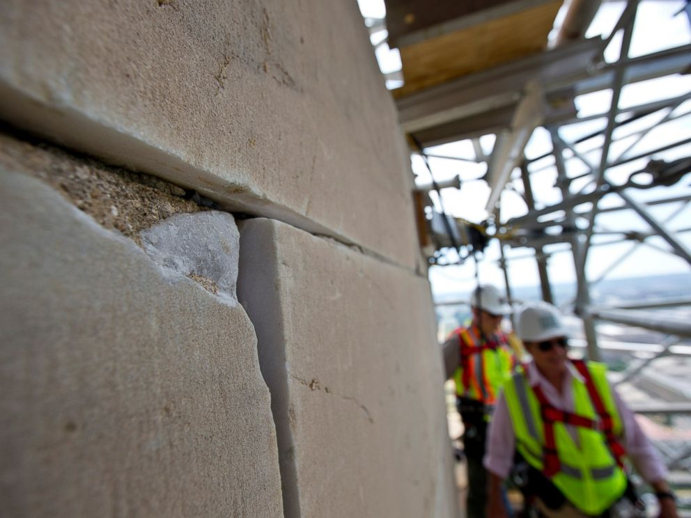 PHOTO: This June 2, 2013 file photo shows a damaged stone on the Washington Monument in Washington, DC.