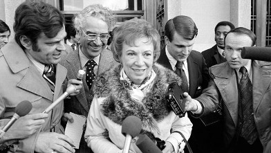 PHOTO: Rose Mary Woods, President Richard Nixon's personal secretary, and her attorney, Charles S. Rhyne are surrounded by newsmen, Feb. 2, 1974, as they leave U.S. District Court in Washington.