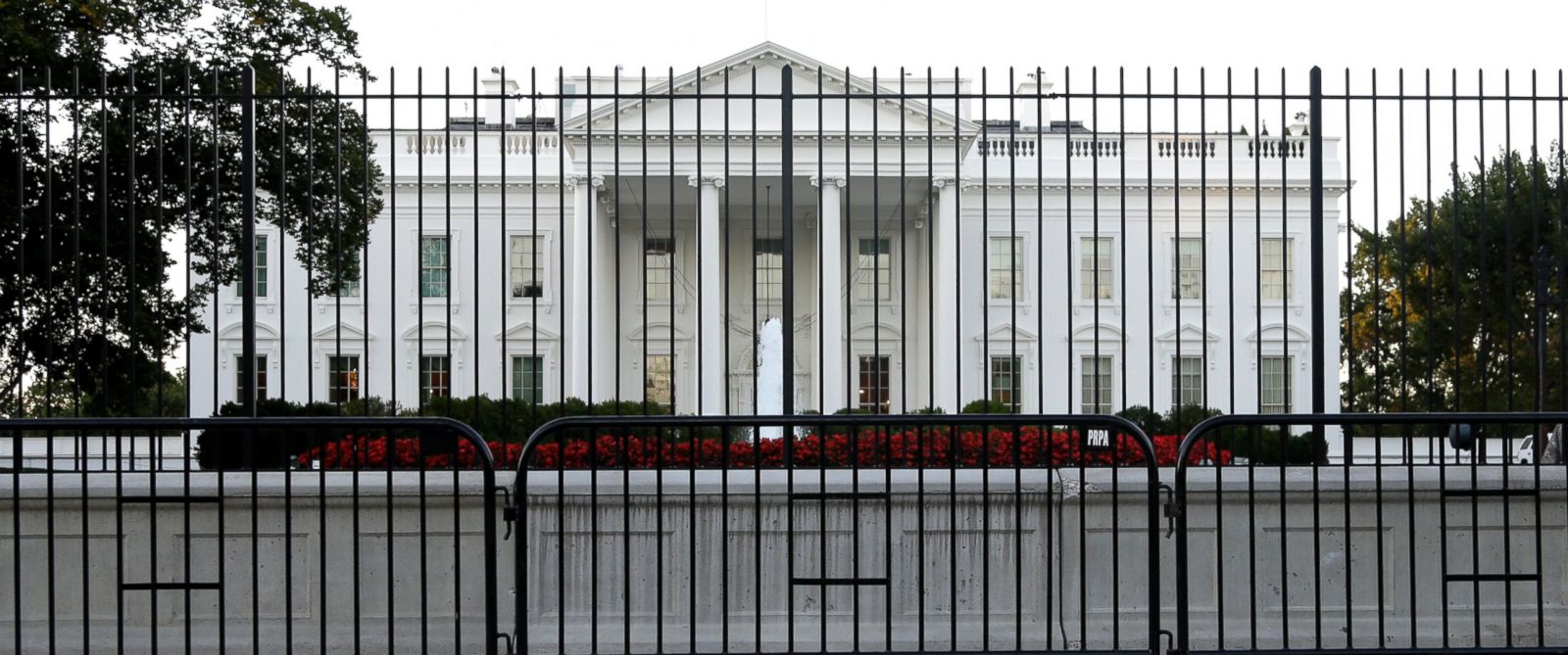 PHOTO: A perimeter fence sits in front of the White House fence on the North Lawn along Pennsylvania Avenue in Washington, Sept. 22, 2014.