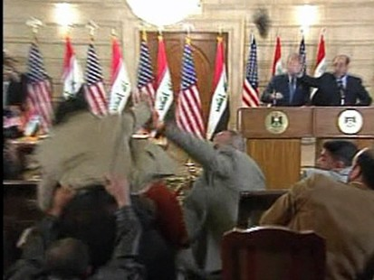 President Bush attacked with shoe