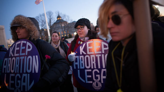 PHOTO: Attendees listen during a candlelight vigil organized by the National Organization for Women in front of the U.S. Supreme Court Jan. 22, 2013 in Washington D.C. The vigil commemorates the 40th anniversary of Roe v. Wade.