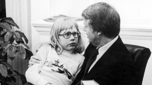 PHOTO: American President Jimmy Carter talks with his daughter Amy, who sits on his lap, in the Oval Office of the White House, Washington DC, 1978.