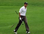 PHOTO: US President Barack Obama walks to take a putt shot at the 9th hole at Mink Meadows Golf Club in Vineyard Haven on Marthas Vineyard, Massachusetts, on August 25, 2010.