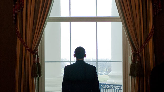 obama looking out whitehouse window