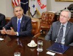 PHOTO: U.S. President Barack Obama, right, speaks while Timothy F. Geithner, U.S. treasury secretary, left, House Speaker John Boehner, a Republican from Ohio, middle, listen during a meeting in the Roosevelt Room of the White House in Washington, D.C., N