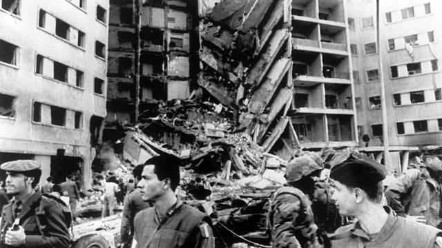 PHOTO: A Lebanese policeman, a French soldier, a U.S. Marine and a French soldier stand guard, April 18 1983, in front of the destroyed section of the U.S. embassy in Beirut.
