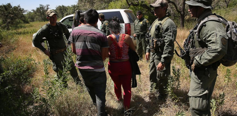 PHOTO: U.S. Border Patrol agents detain undocumented immigrants with the help of helicopter support from the U.S. Office of Air and Marine north of the U.S. and Mexico border on Aug. 6, 2015 near Falfurrias, Texas.