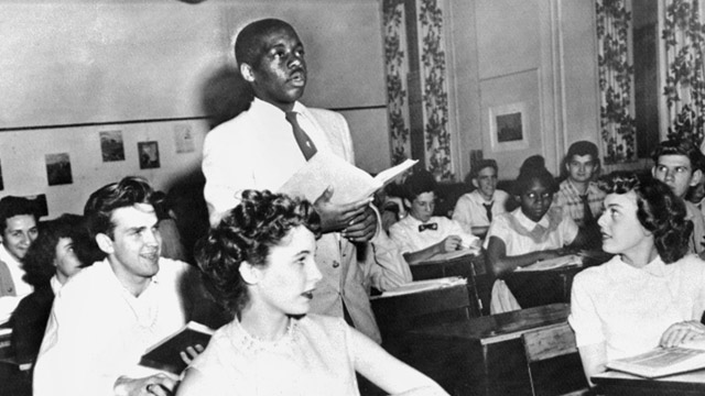 PHOTO: Black student recites lesson in class
