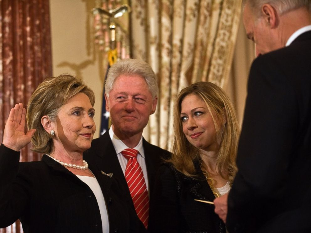 PHOTO: US Secretary of State Hillary Clinton is ceremonially sworn in by Vice President Joe Biden as her husband former president Bill Clinton and daughter Chelsea look on at the State Department in Washington, Feb. 2, 2009.