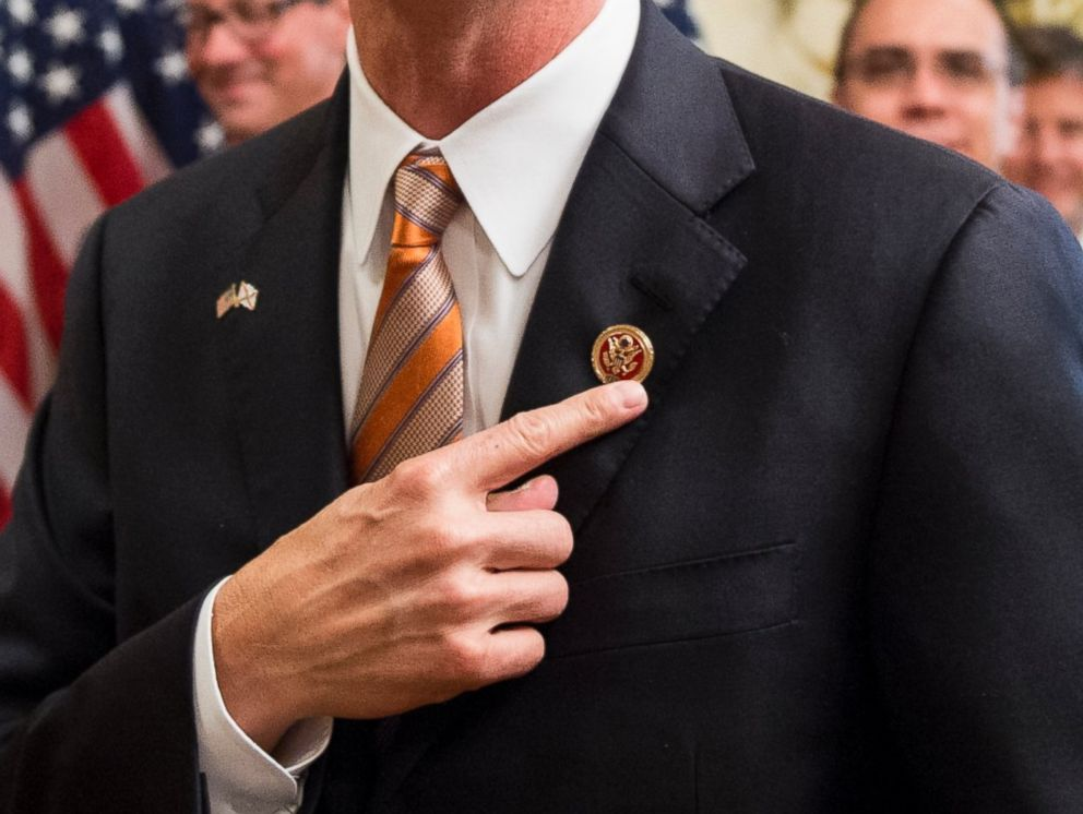 PHOTO: Curt Clawson points to his member pin after the ceremonial swearing-in photo opportunity in the Capitol on June 25, 2014.