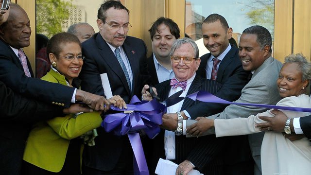 PHOTO: Council member Marion Barry, Congresswoman Eleanor Holmes-Norton, mayor Vincent Gray, council member Jim Graham, Malik and Chip Ellis of Ellis Development, Myla Moss are seen cutting the ribbon during the official opening at the Howard Theatre on A
