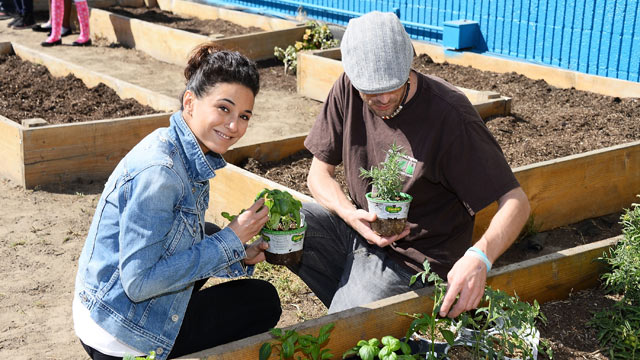 PHOTO: Emmanuelle Chriqui and schoolteacher Joseph Montana celebrate Earth Day with the Environmental Media Association at Cochran Middle School on April 18, 2013 in Los Angeles.